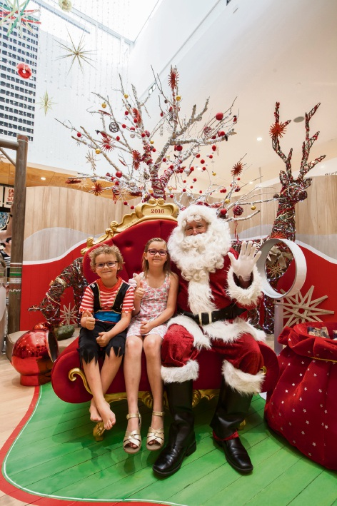 Logan (6) and Autumn (8) Kelly, of Duncraig with Santa. Picture: ASCP Photography