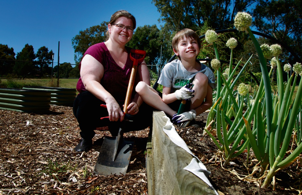 Sherrii Richardson with her son Zachary Pitham (10) in the Camillo Community Garden.  Picture: Marie Nirme  www.communitypix.com.au   d462370
