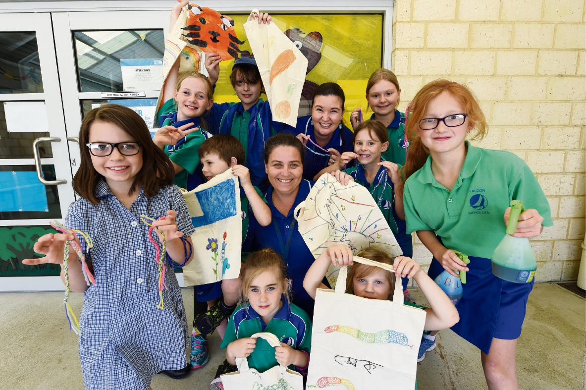 Camp Australia staff Jodie Davey and Helen Elias with Falcon Primary School |students and the gifts they have made for children in Bangladesh.