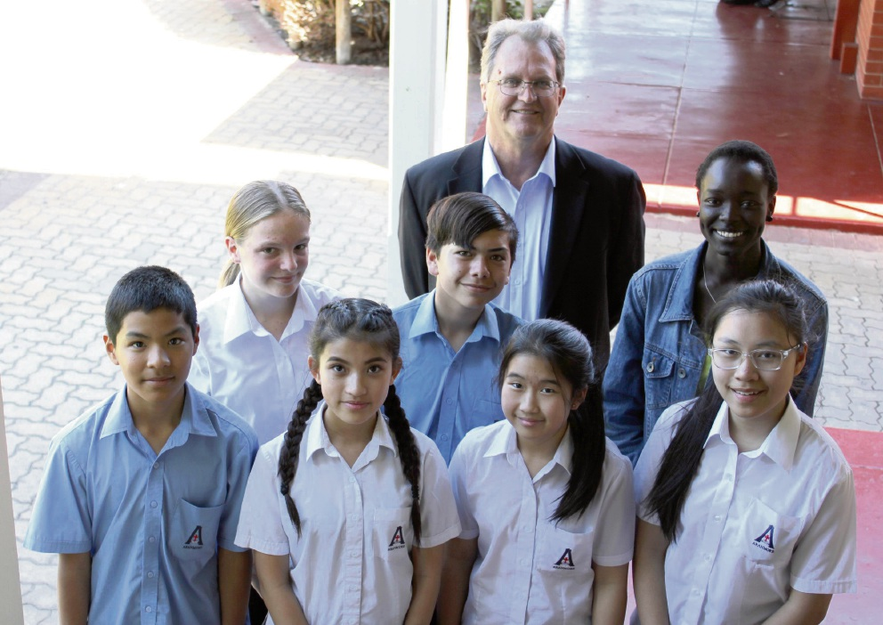 Aranmore Catholic College students (front) Ty Mach, Jessica Ta, Chloe Ngo, Anh Le, (middle) Molly Sinclair, Tyron Bin Hitam-Keeffe, Ayuol Manyok and Principal Declan Tanham.