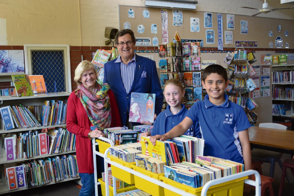 Volunteer Anne Tuckett, Mt Lawley MLA Michael Sutherland and Yokine Primary School students Ally Davis and Noah Furtado.