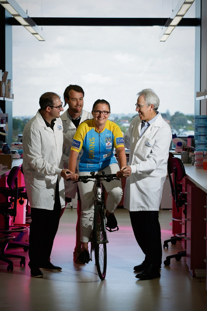 Dianne Beveridge (research officer; on bike) with Michael Epis (research officer), Louis Parker (PhD candidate) and Peter Leedman (director Harry Perkins Institute). Picture: Andrew Ritchie