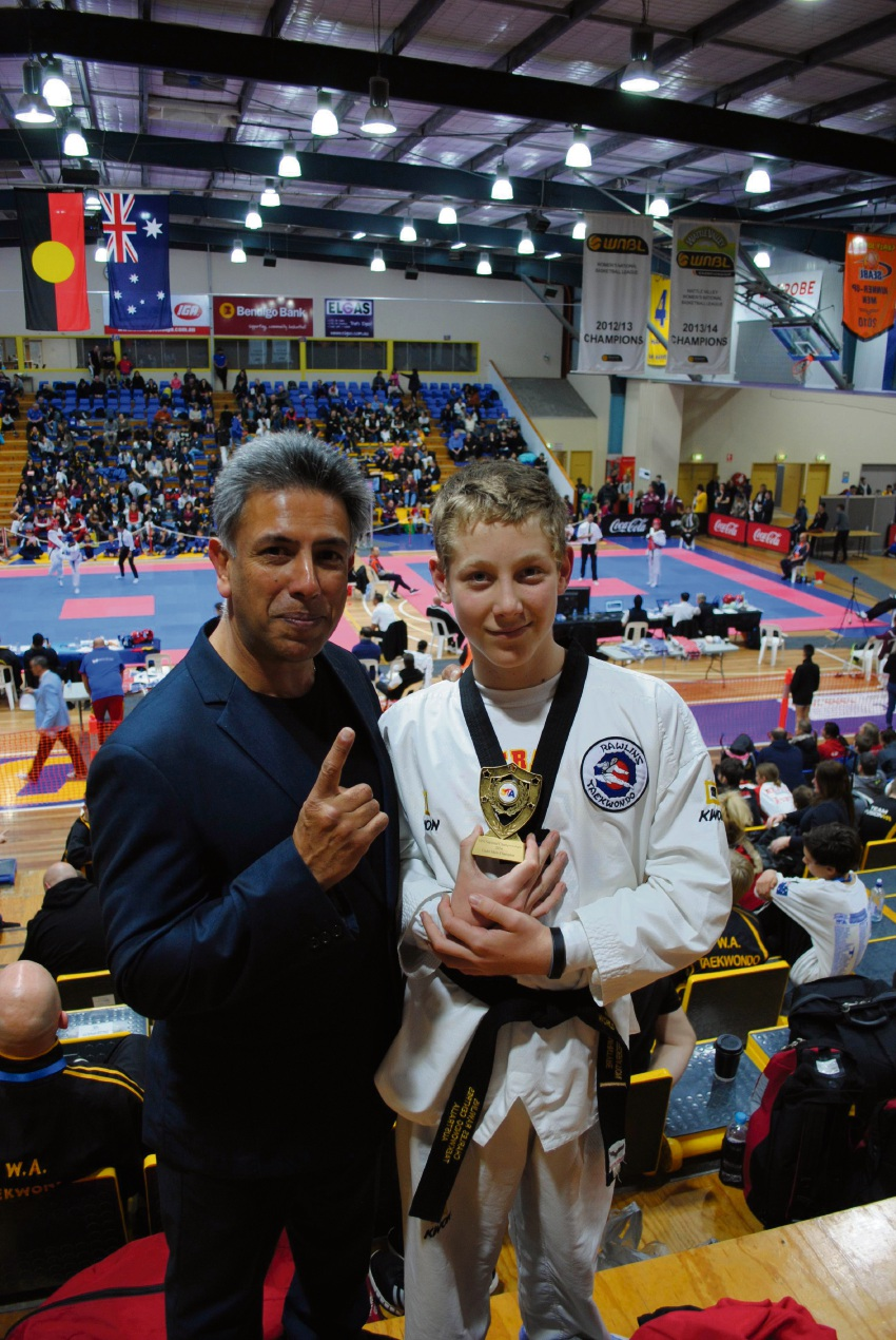 Coach Charles Rawlins with national champion Harrison McIntyre.