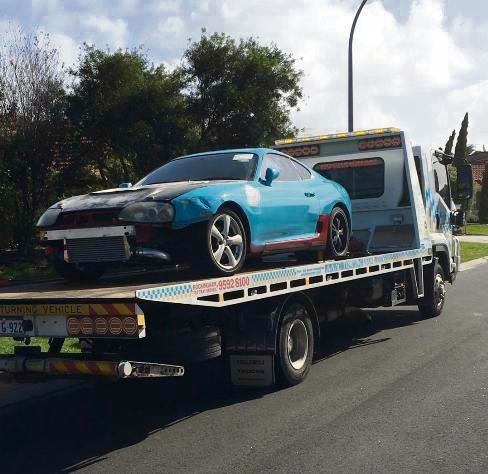 The Toyota Supra being seized by police.