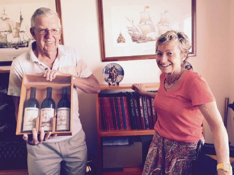Jan and Gail Willems in front of the Duyfken print with their three bottles of port.