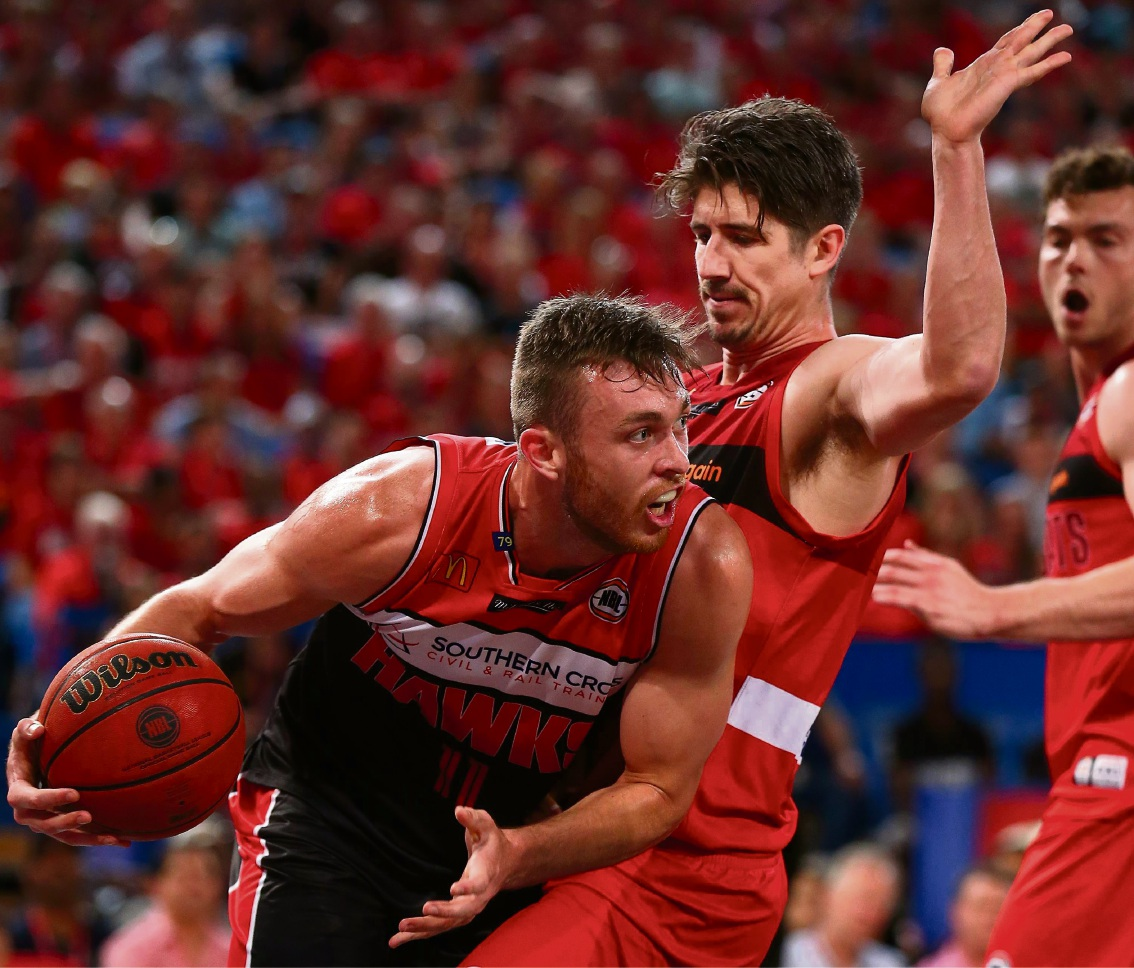 Greg Hire defends against Nick Kay in the Perth Wildcats' loss to Illawarra Hawks at Perth Arena earlier this week.