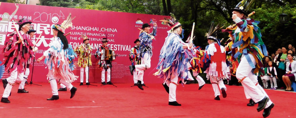 The Mad Tatters Morris folk dancing group performing in Shanghai.