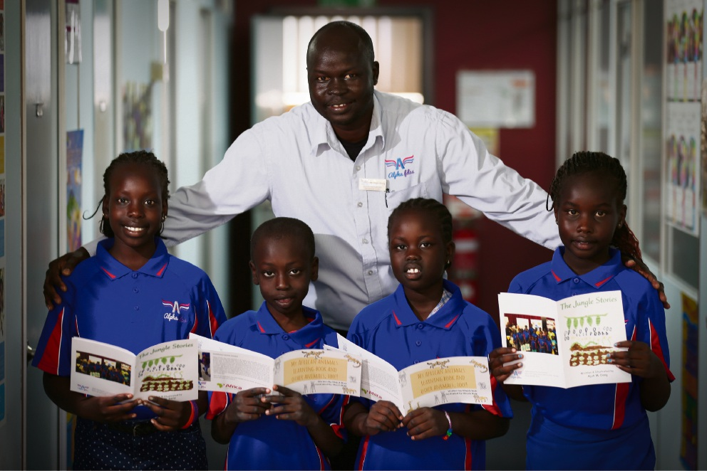 Peter Deng with Nyankiir Deng (11), Majok Riak (8), Akuch Riak (9) and Ajoh Deng (9). Picture: Andrew Ritchie