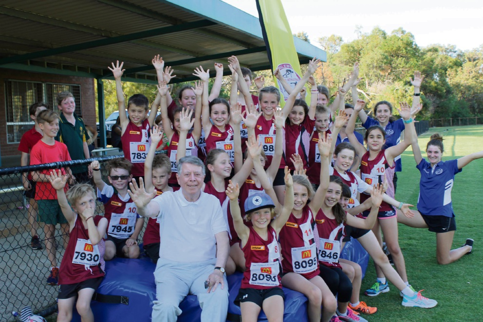 Cr Terry Tyzack with members of the Inglewood Little Athletics Club.