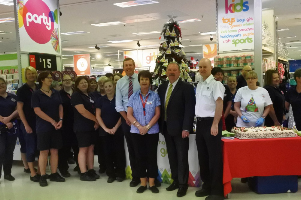 Baldivis Labor candidate Rhys Whitby, Rockingham Mayor Barry Sammels, Salvation Army Lieutenant Darrell Wilson and Kmart staff at the launch of the Kmart Wishing Tree.