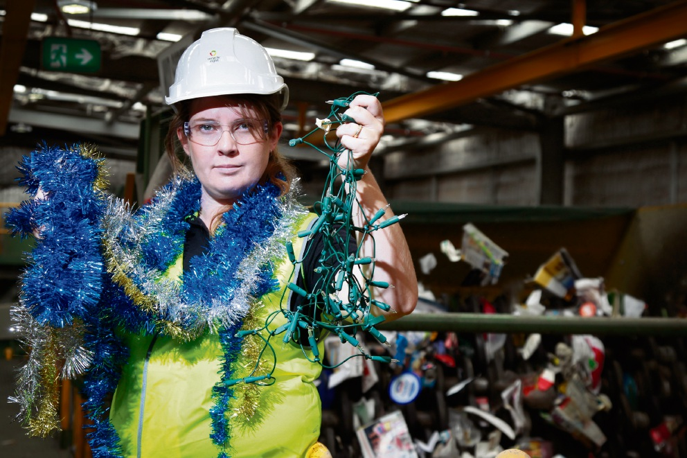 Council Education Officer Emma Baker with the unwanted Christmas decorations at the recycling plant in Canning Vale. d462798