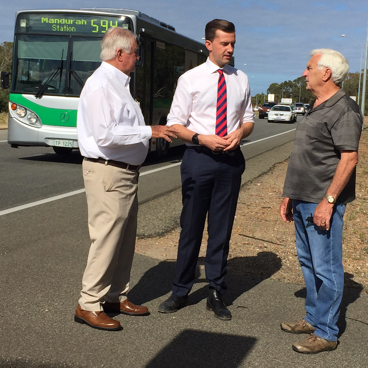 Dawesville Liberal candidate Zac Kirkup discusses bridge traffic problems with residents Ron Jones and Ross O'Malley.
