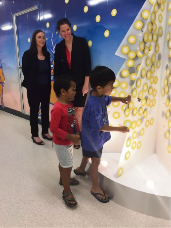 Helping hands: Children put stars on the feature wall, each worth $1.