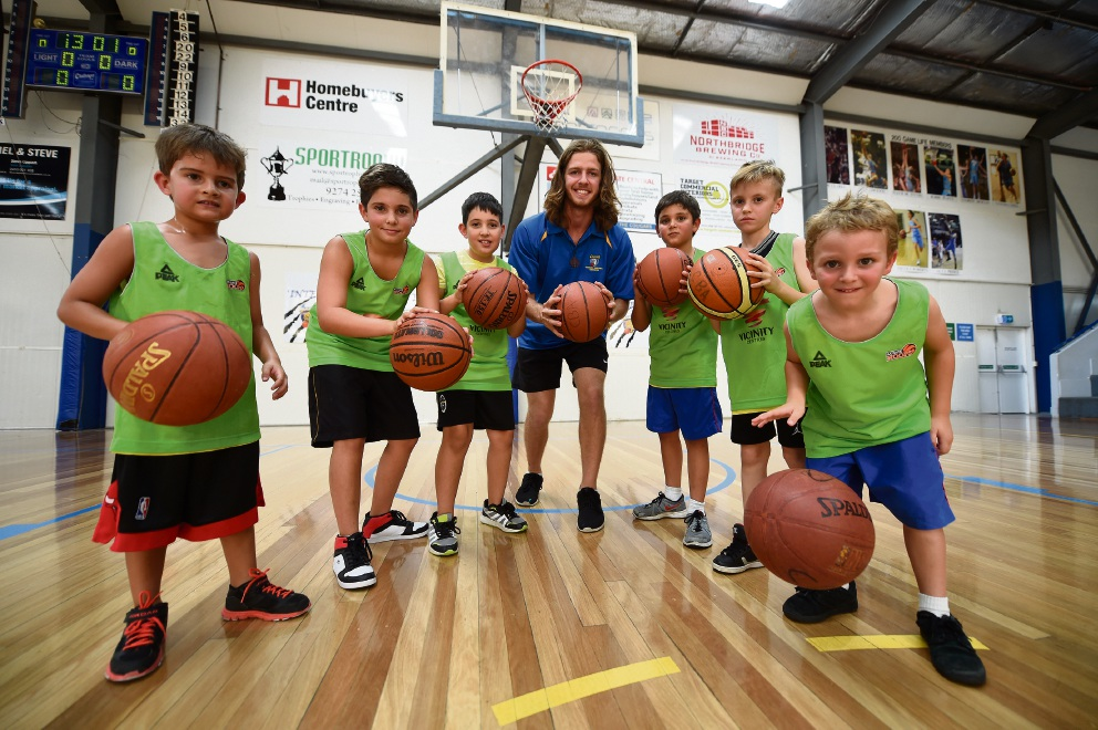 Chayse Stoddart (5), Jacob Danzi (11), Alex Garzo (9), coach Jake Harris, Eli Russotti (9), James Watson (8) and Silas Russotti (5) at an Aussie Hoops session. Picture: Jon Hewson