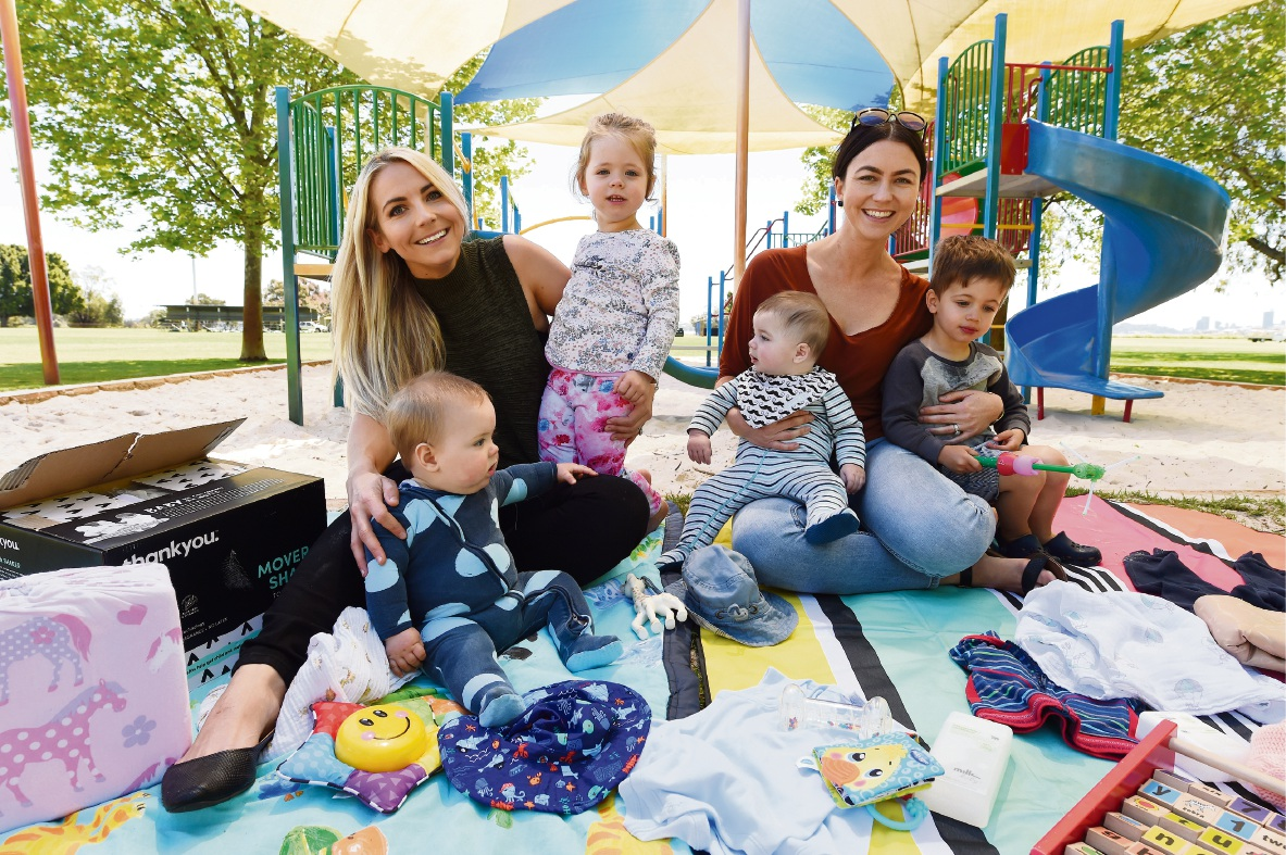 Tara Mitchell with Scarlett (2) and Tommy (7 months), and Catherine Sharbanee with Ben (3) and Ethan (3 months). Picture: Jon Hewson