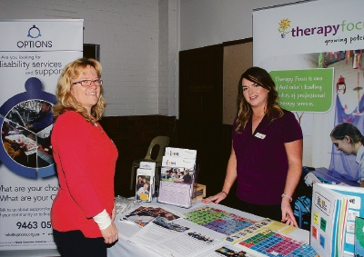 Wendy Stanley and Gretta Lane at the Therapy Focus display during the WA NDIS community event held in the Armadale hall.