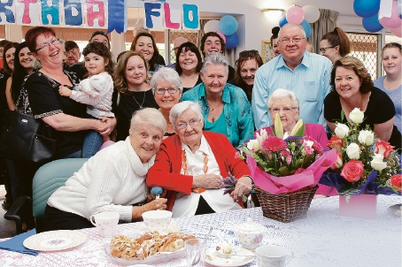 Flo Johnston (red jumper) surrounded by five generations of friends and family on her 102nd birthday.