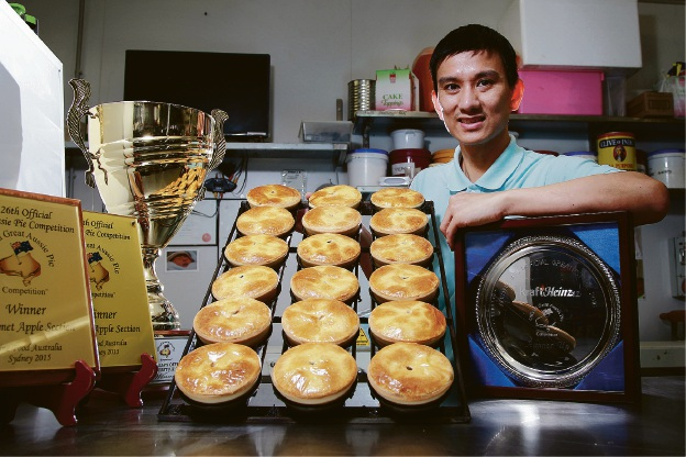 Pie maker Andy Le with the awards he won at the Official Great Aussie Pie competition in Melbourne. Picture: Marie Nirme