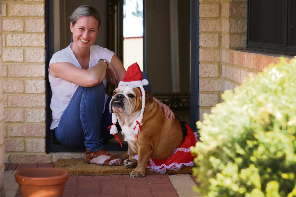 Kate Watts, with her dog Blossom, is looking forward to a family Christmas. Picture: Andrew Ritchie  www.communitypix.com.au   d462863