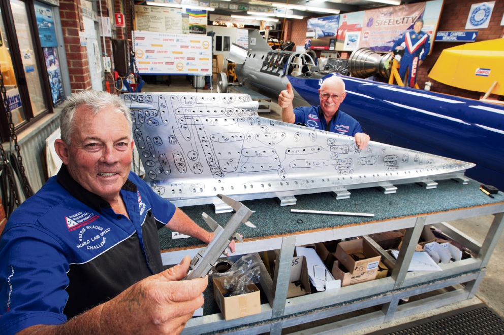 Rosco McGlashan (front) working on the tail fin with mechanical engineer Chris Denmunck. Picture: Bruce Hunt d462578