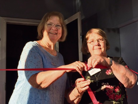 Kaye Seeber and  Sister Helen Anne Johnston cut the ribbon to officially open the cottage.