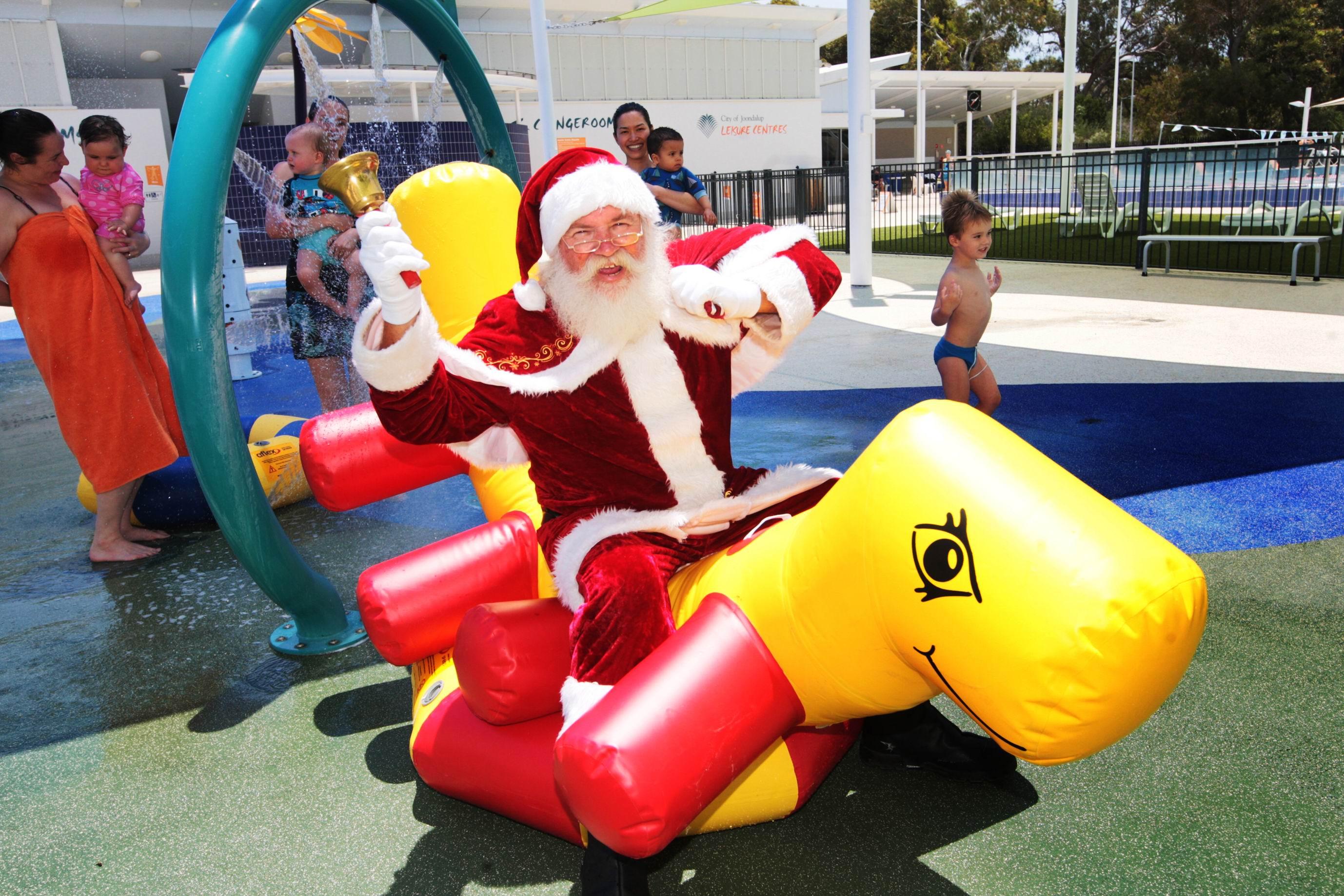 Santa tries out the Craigie centre's toys. Picture: Bruce Hunt d462636