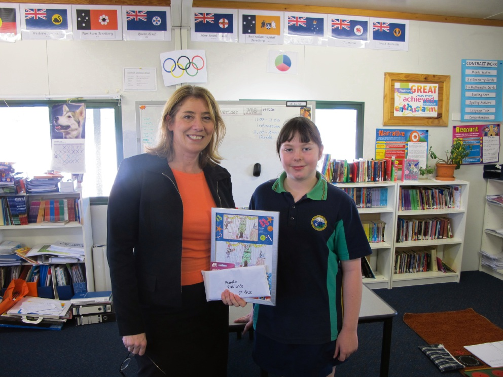 Rita Saffioti with Christmas card winner Pamela from Riverlands Monterssori School.