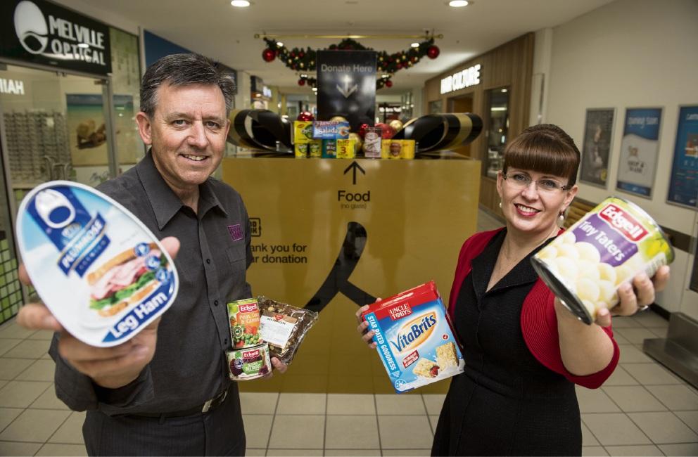 Foodbank WA chief executive Greg Hebble and Hawaiian's Kate O'Hara at the Giving Box in Melville Plaza.