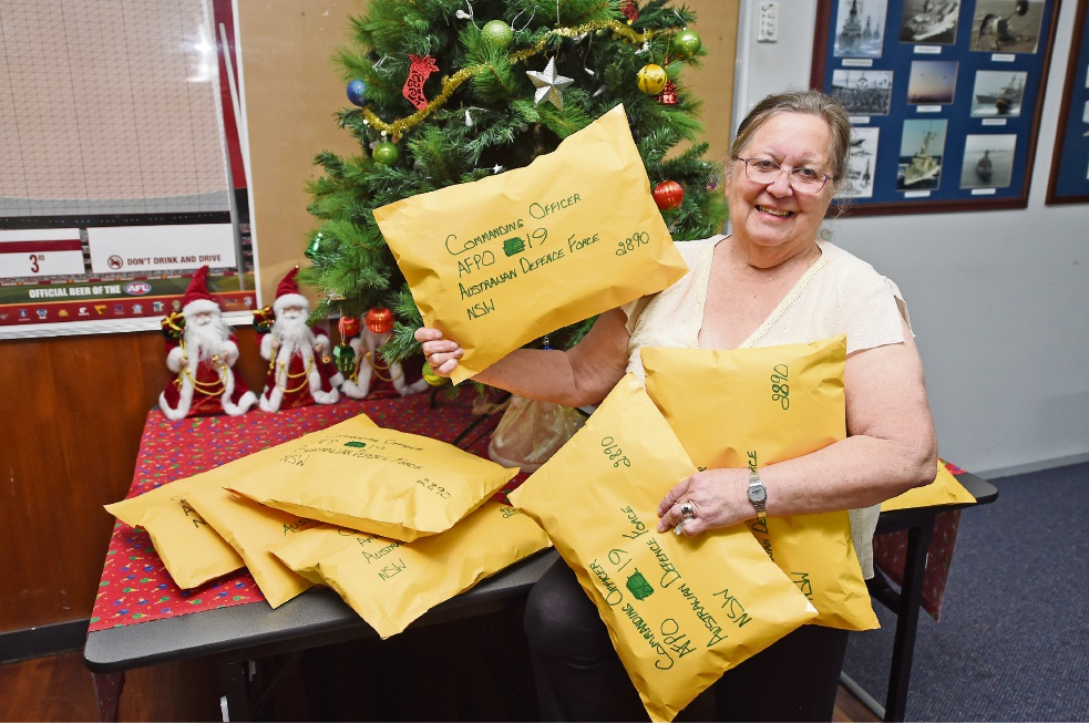 Jenny Sciortino with packages for troops in the Middle East. Picture: Jon Hewson    d463113