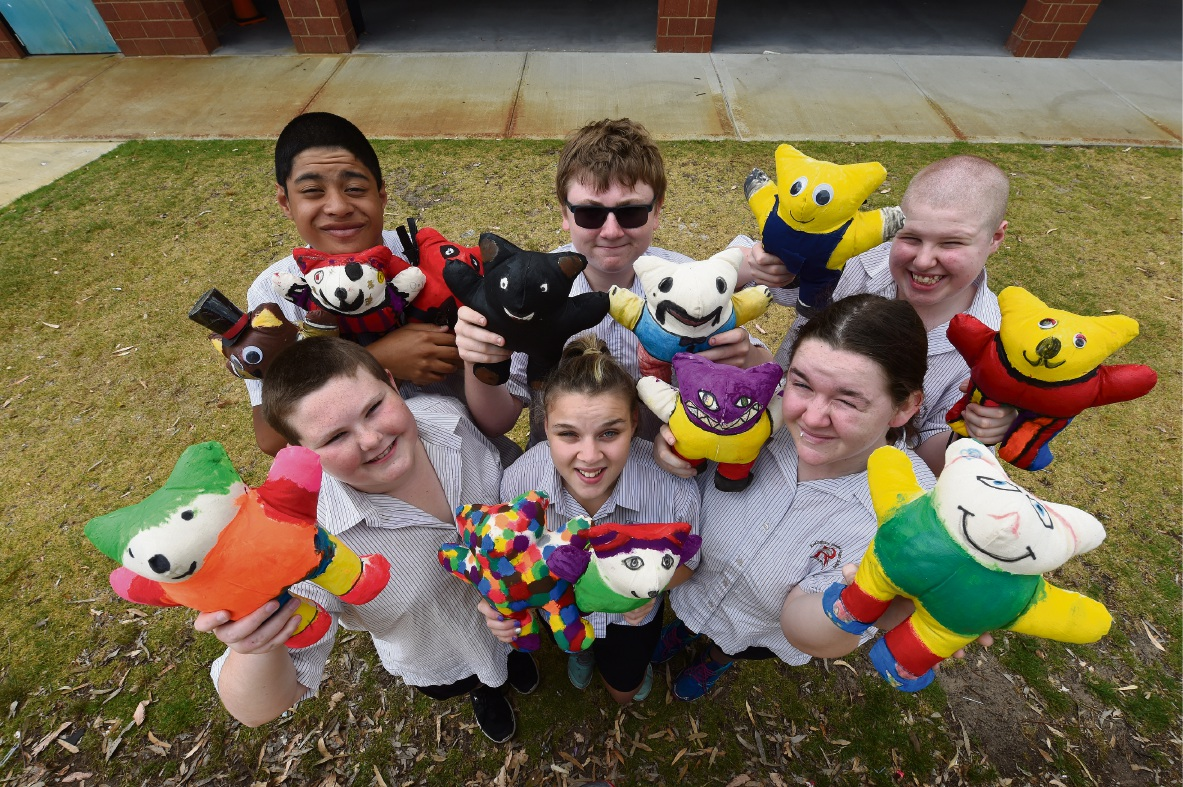 Jayden Broodkoorn, Ben Watkins and Akira Simpson (back), Jason Bawden, Bella Frawley and Rachel Pearson have all made bears for children in Cambodia. d462603