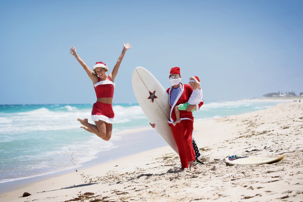 Beth Walkemeyer with Rebecca Cryer and her nephew Harrison Cryer (2), participants in the annual Santa Surf event. Picture: Andrew Ritchie