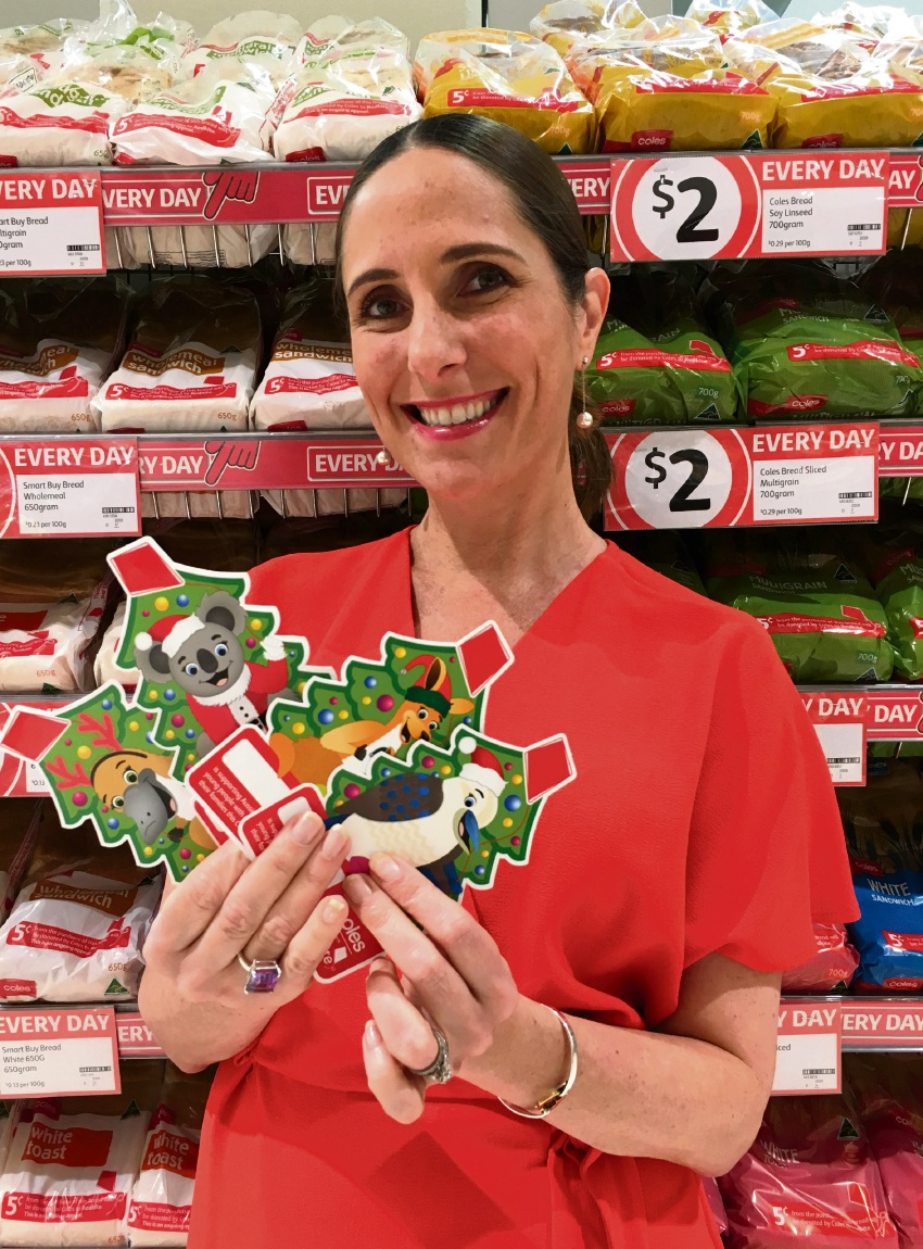 Redkite's Monique Keighery with the Christmas donation cards at Coles.