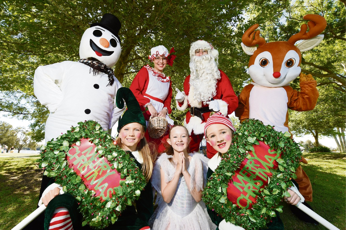 (Back) Emma Redgwell (Frosty), Emma Murcia (Mrs Clause), Harry Docherty (Santa) and Isabel Docherty (Rudolf) with (front) Lauren Brown and Chloe and Tahli Redgwell. Picture: Jon Hewson