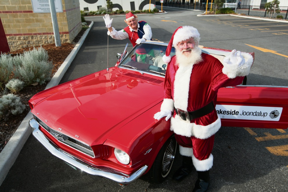 Mustang moment: Santa and his helper went for a spin. Picture: Bruce Hunt        www.communitypix.com.au   d462749