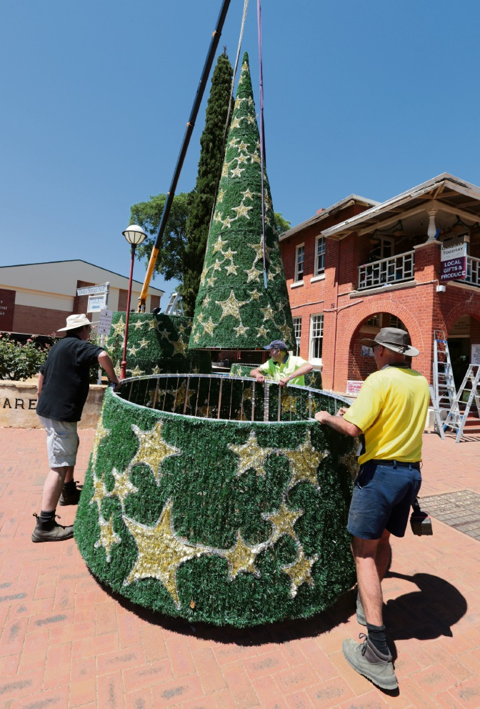 The shop's Christmas tree erected with the aid of a crane in the main street of Toodyay. Picture: David Baylis