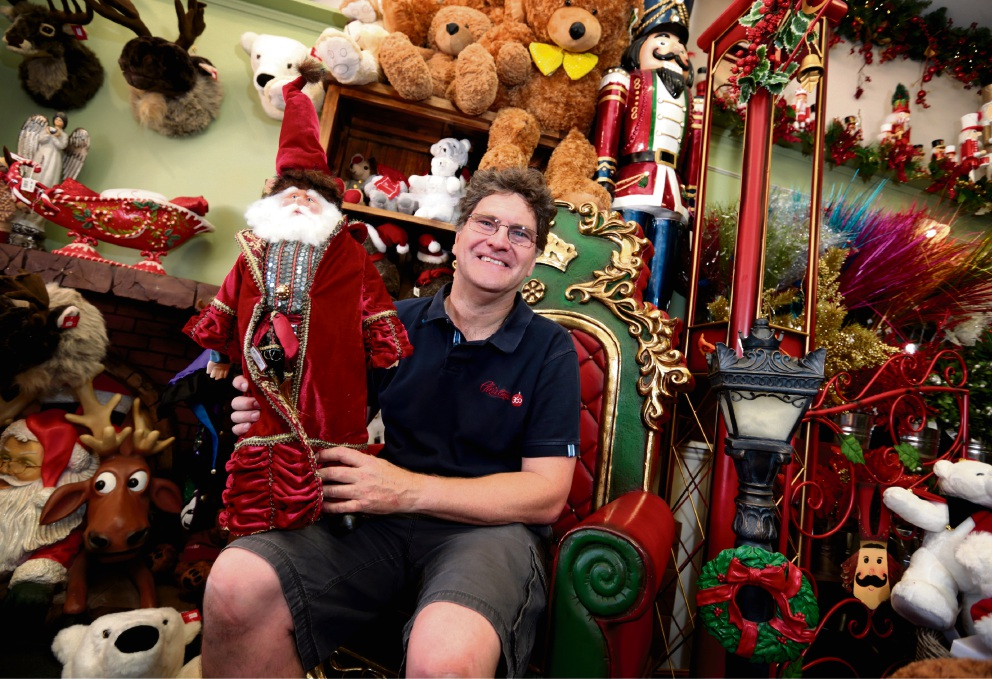 Toodyay's Christmas King Sean Byron on his 'throne' inside Richard's Christmas 360. Picture David Baylis