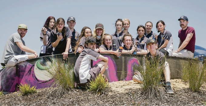 Baldivis Secondary College students help paint mural at Rivergums BMX track