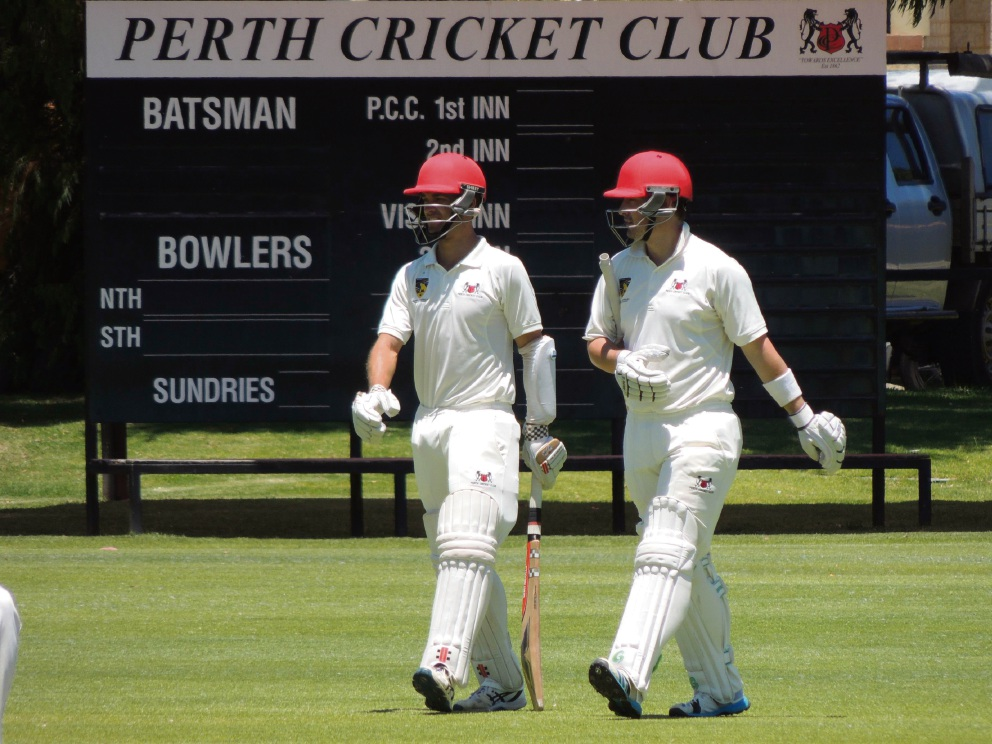Jacob Snadden and Tom Casey walking out to bat Saturday against Scarborough.