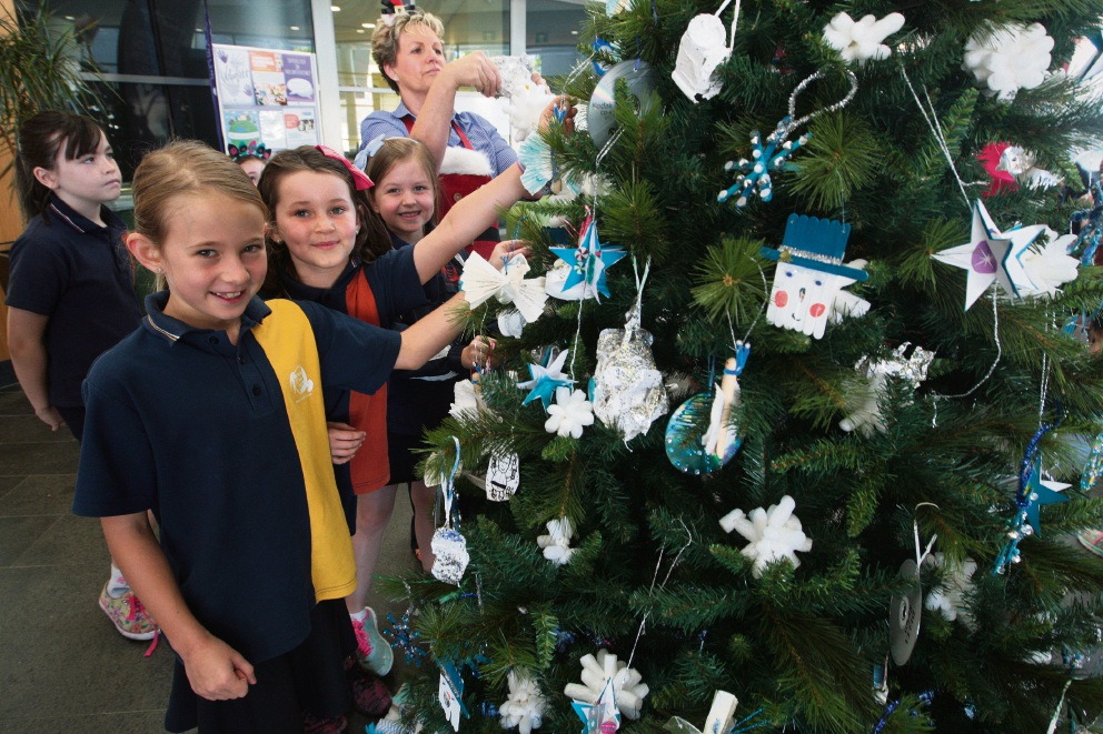 Hocking Primary School students Daisy Brayshaw, Abigail Trim and Tia  Delamotte. Picture: Bruce - City Of Wanneroo Students Decorate Christmas Trees Community News