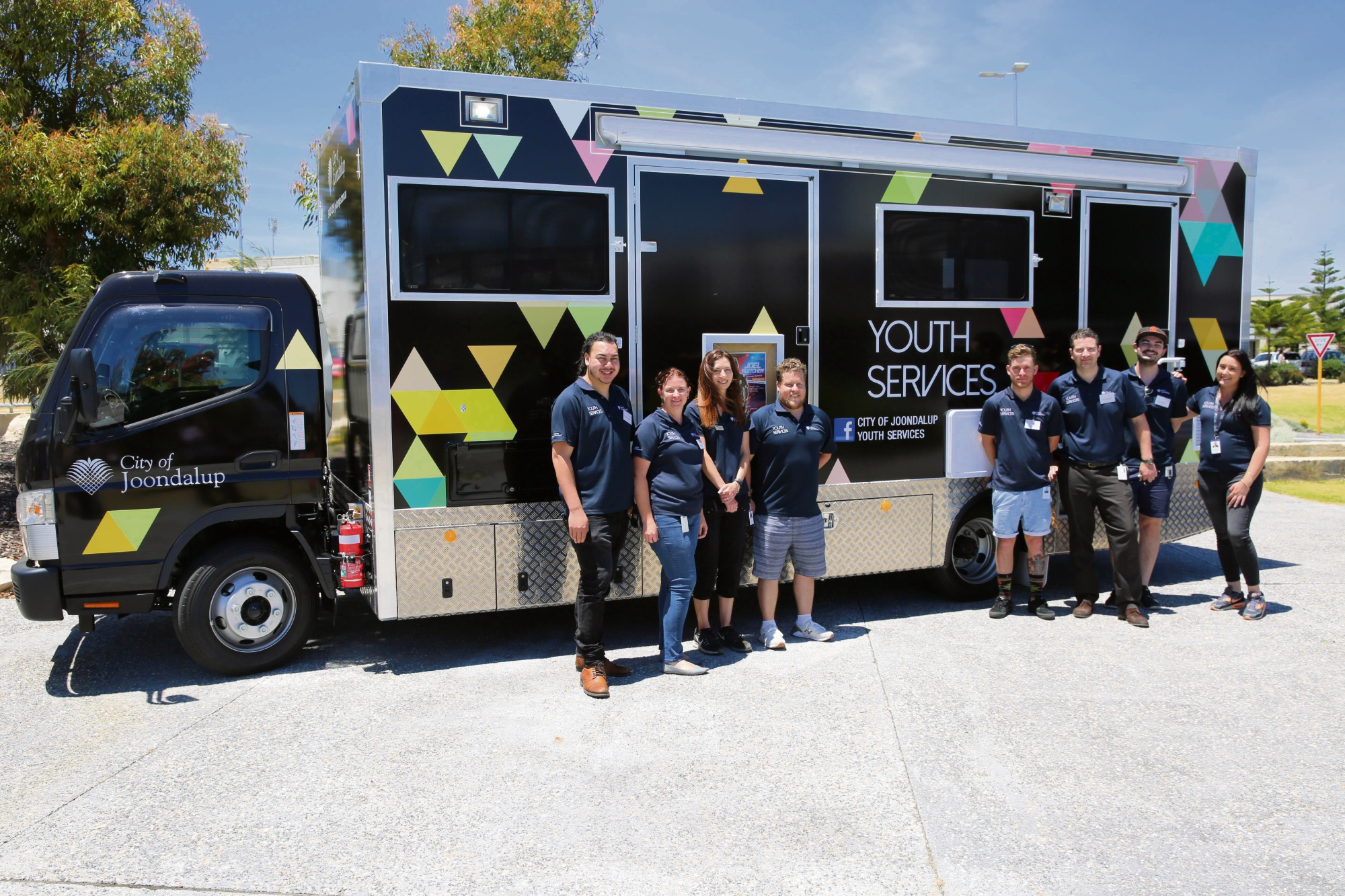 The City of Joondalup's youth service team with the strikingly coloured new truck.