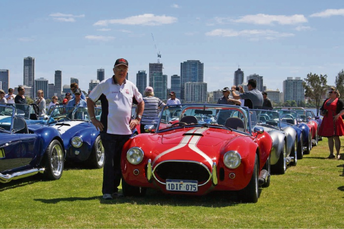 Cobra Car Club of WA Graham Ullock admires some of the cars on the South Perth foreshore.