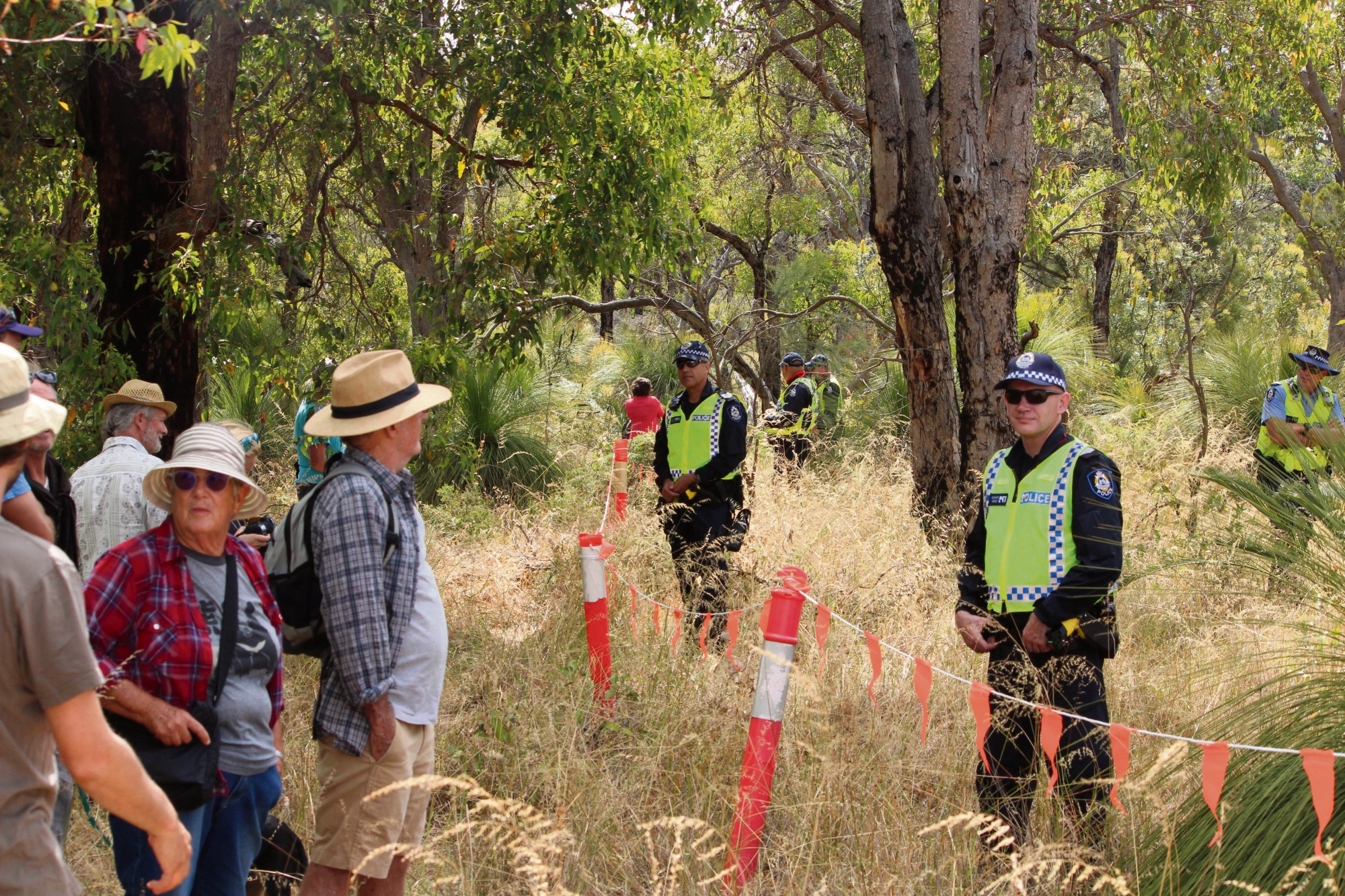 Police keep watch over an exclusion zone where contractors are undertaking preliminary tests for Roe 8. Photo: Bryce Luff