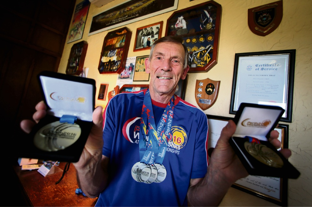 Bert Carse with his medals and awards from the Masters Championships in Perth. Picture: David Baylis