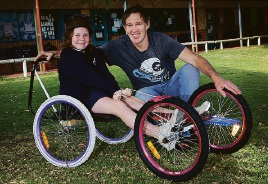 Walt Ramage and daughter Ryah (9) of Currambine with their billy cart.