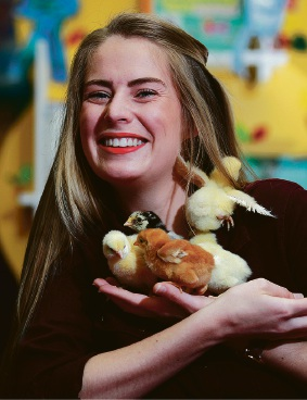 Librarian Lilly Kensell with week old chicks Picture: Marie Nirme
