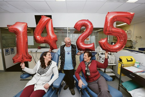 Louise Branch-Smith gives blood with her parents Gary and Anne Herren. Picture: Jon Hewson
