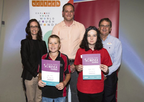 Carcoola Primary School students Bianca Newnham and River Robinson receiving their award from Woodside's Yvette Manolas, UWA researcher Scott Draper and Scitech chief executive Alan Brien.