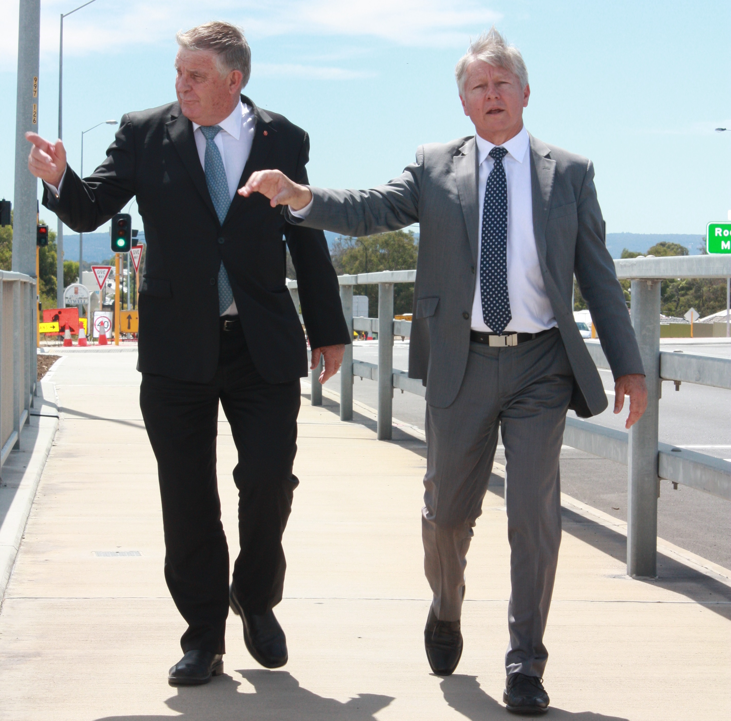 Senator Back and Transport Minister Bill Marmion inspect the new freeway upgrades.