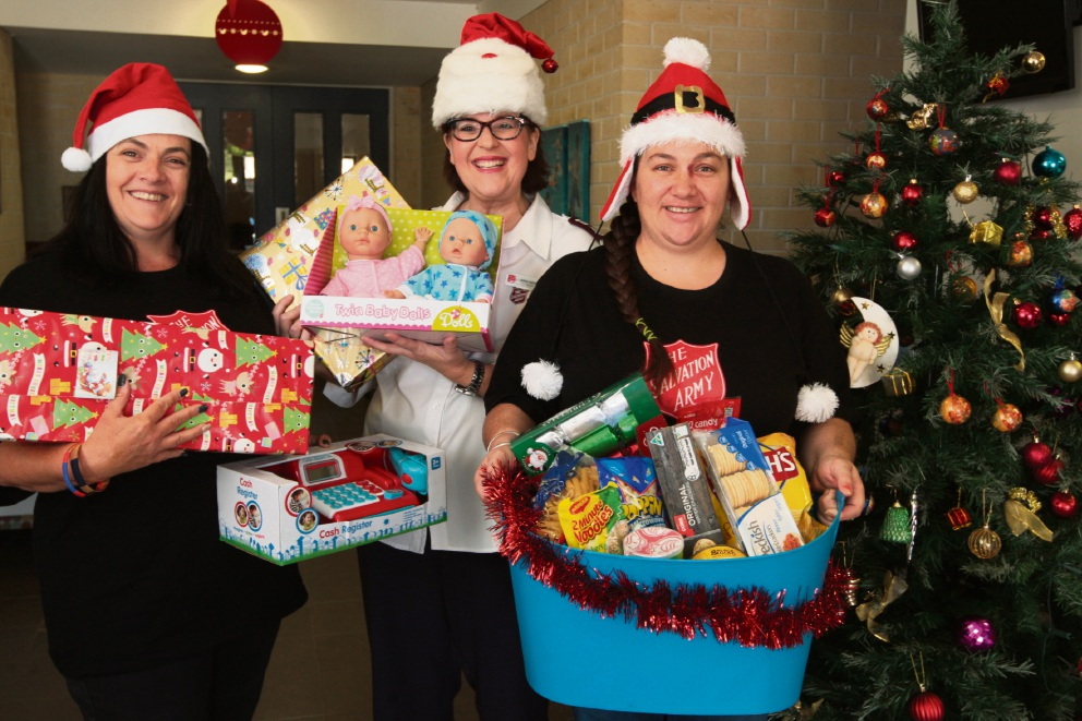 Michelle Foster, Major Nikki Novell and Renee Koellner with some of the items donated to the Salvation Army in Merriwa. Picture: Bruce Hunt