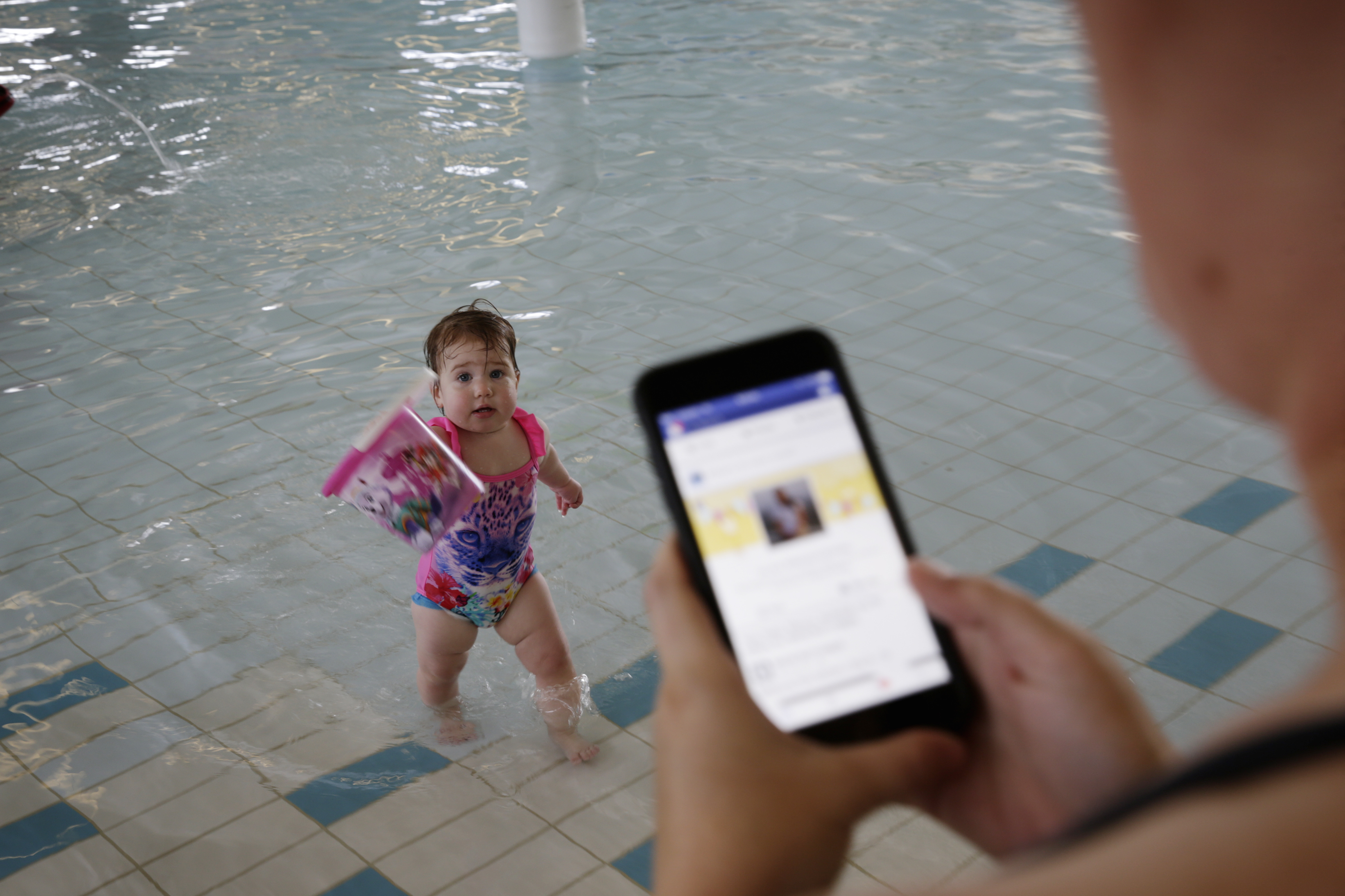 Kristie Jones with daughter Violet Jones (1). Royal Life Saving is launching their summer safety campaign at Beatty Park. The campaign is geared around 'watch around water', urging parents to get off their phones while the kids are in the water. Photo: Andrew Ritchie